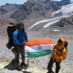 Arzan proudly raising the Indian Flag with Friend on Aconcagua Mountain in Argentina